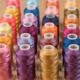 Rows of thread. Close up of colorful spools of thread Royalty Free Stock Photography