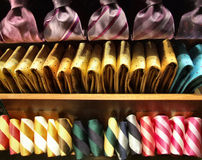 Rows of ties on a shop shelf. Rows of colorful fashionable and elegant ties. Man's wear Stock Images