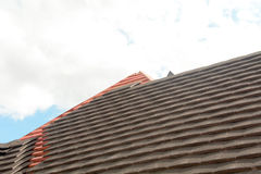 Rows of tiles being fixed to roof Stock Photography