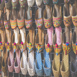 Rows of typically oriental shoes at the market in Dubai Royalty Free Stock Photography