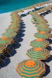 Rows of umbrellas on the beach Stock Photos