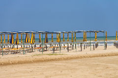 Rows of umbrellas and deck chairs Stock Photography