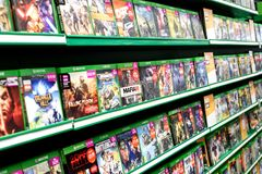 Stacks of Xbox One Video Games in a Game Store Stock Photo