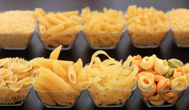 Rows of various shapes of pasta. On a black background Stock Photos