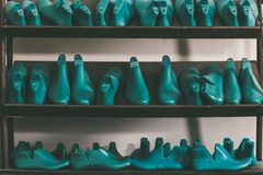 rows of various shoe lasts royalty free stock photos