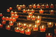 Rows of votive candles in a Catholic church. Landscape format royalty free stock photos