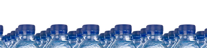 Rows of water bottles Royalty Free Stock Images