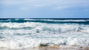 Rows of waves coming to shore Royalty Free Stock Photo