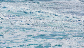 Rows of waves coming to shore Royalty Free Stock Photography