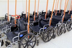 Rows of wheelchairs,ready for travelers who might need them,Denver Airport,2015. Rows of wheelchairs,lined up and ready for travelers who might need them, Denver Royalty Free Stock Images