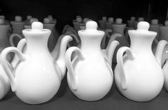 Rows of white ceramic jugs. Black and white picture of rows of white ceramic jugs on display for sale at a store Royalty Free Stock Photography