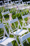 Rows of white chairs arranged for a wedding ceremony Stock Images