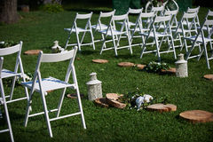 Rows of white chairs arranged for a wedding ceremony Royalty Free Stock Photography