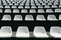 Rows of white chairs in an outdoor hall for carrying out entertainment Stock Photos