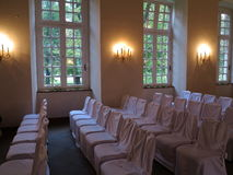 Rows of white chairs in wedding hall Royalty Free Stock Photography