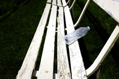 Rows of White Park Benches for Sitting on Green Grass Royalty Free Stock Photos