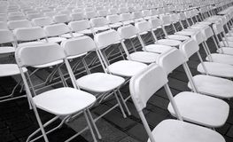 Rows of White Plastic Chairs Royalty Free Stock Image