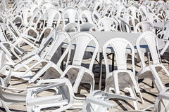 Rows of white plastic chairs. Stock Image
