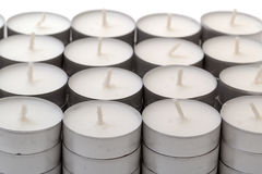 Rows of white wax tea light candles Royalty Free Stock Photo