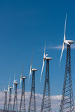 Rows of wind turbines capture wind for energy Stock Image