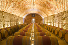 Rows of Wine Barrels in a Cellar Stock Images