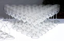 Rows of wine glasses waiting to be used Stock Photo