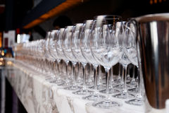 Rows of wineglasses in bar Stock Photos