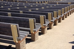 Rows of wood seats. Outside Royalty Free Stock Image