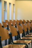 Rows of wooden chairs Royalty Free Stock Photo