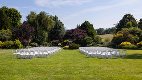 Rows of wooden chairs set up for wedding Royalty Free Stock Photo