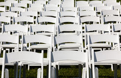 Rows of wooden chairs set up for wedding Royalty Free Stock Photography