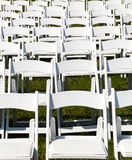 Rows of wooden chairs set up for wedding Royalty Free Stock Images