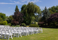 Rows of wooden chairs set up for wedding Royalty Free Stock Image