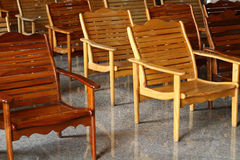 Rows of wooden chairs in Thai temple. Stock Photo