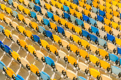 Rows of yellow and blue stadium seats background Stock Photo