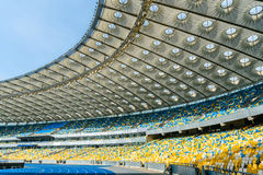 Rows of yellow and blue stadium seats Royalty Free Stock Image