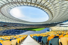 Rows of yellow and blue stadium seats Royalty Free Stock Photo