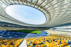Rows of yellow and blue stadium seats Stock Images