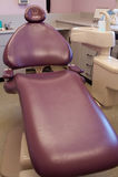 Roxo da cadeira do dentista Foto de Stock Royalty Free
