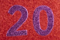 Roxo do número vinte sobre um fundo vermelho anniversary Fotos de Stock