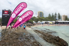 Roxy Pro 2011. Image was taken of some Roxy pro signs and the spectators watching the  Roxy pro with the competitors tent in the background.  The competition was Stock Photos