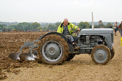 Roy Jury, Ploughman. BASINGSTOKE, UK - OCTOBER 12, 2014: Roy Jury competing in the second day of the British National Ploughing Championships organised by the Royalty Free Stock Photos