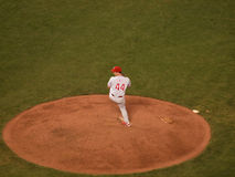 Roy Oswalt lifts leg to throw pitch from mound in relief Royalty Free Stock Images
