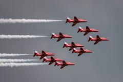 Free Royal Air Force RAF Red Arrows Formation Aerobatic Display Team Flying British Aerospace Hawk T.1 Jet Trainer Aircraft. Stock Photo - 119331680