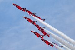 Royal Air Force RAF Red Arrows formation aerobatic display team flying British Aerospace Hawk T.1 Jet trainer aircraft. Stock Image