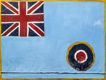Royal Air Force roundel on an old metal background. Royal Air Force roundel and Union Jack flag emblem of the United Kingdom painted on an old metal background Royalty Free Stock Photos