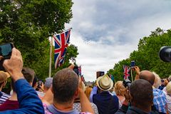RAF 100 year celebration. The Royal Air Force 100 year celebration in the Mall London near Buckingham palace. Here you can see people taking photos and video of Royalty Free Stock Image