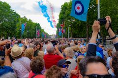 RAF 100 year celebration. The Royal Air Force 100 year celebration in the Mall London near Buckingham palace. Here you can see the red have just passed leaving a Royalty Free Stock Photos