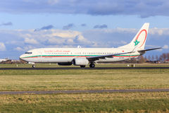 Royal Air Maroc aircraft taxiing. A Royal Air Maroc Boeing 737-800 is taxiing at Schiphol Amsterdam Airport Royalty Free Stock Photo
