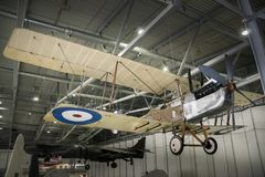 Royal Aircraft Factory RE8 biplane Suspended in Hangar. A Royal Aircraft Factory RE8 biplane suspended in a hangar at the Imperial War Museum, Duxford, England Stock Photography